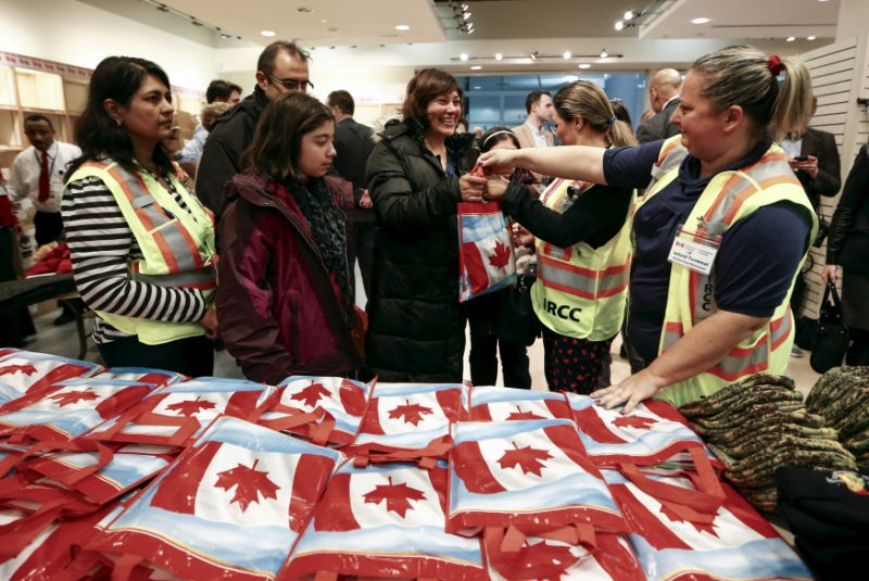 Syrian refugees receive welcome bags  at the Toronto Pearson International Airport in Mississauga
